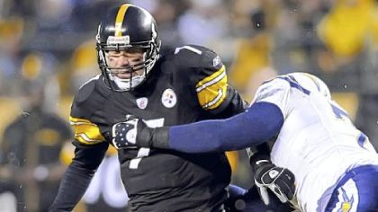 Ben Roethlisberger tries to shake off San Diego&#039;s Jacques Cesaire. Roethlisberger was sacked four times.