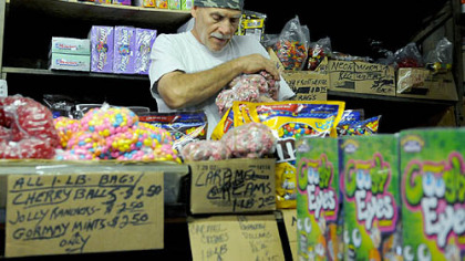 Vincent Ionadi of East Liberty, stocks the shelves  at the Fort Pitt Candy Company in the Strip.