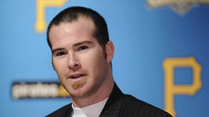 Pirates catcher Ryan Doumit signed a three-year contract that includes a club option for an additional two years.