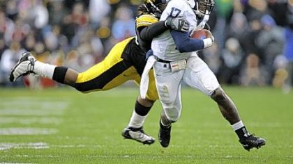 Iowa's Adrian Clayborn tracks down   quarterback Daryll Clark early in Saturday's game in Iowa City, Iowa.