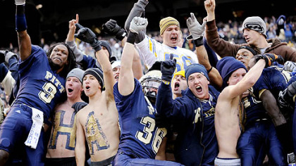 Pitt's T.J. Porter, left, and Mike Toerper jump into the stands after defeating West Virginia, 19-15, in the Backyard Brawl yesterday at Heinz Field.