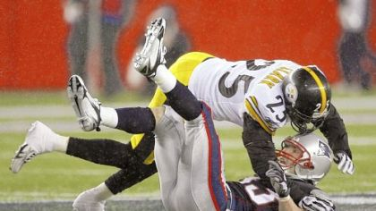 Ryan Clark follows Wes Welker to the ground after delivering his much-discussed hit Sunday.