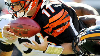 James Harrison sacks Bengals quarterback Ryan Fitzpatrick in the first half.