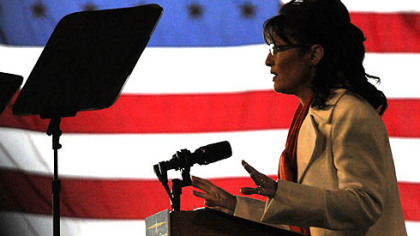 Backed by an American flag, 