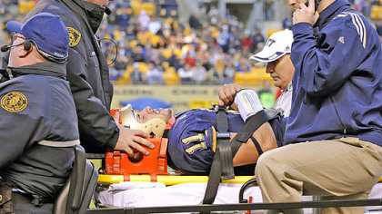 Pitt quarterback Bill Stull is tended to by trainers and emergency personnel after being injured in the third quarter of yesterday's game against Rutgers at Heinz Field.