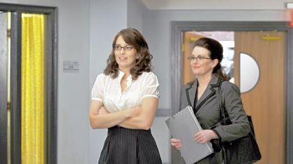 """30 Rock"" returns tonight with Liz, left, played by Tina Fey, needing to impress an evaluator played by Megan Mullally when she decides she wants to adopt a child."