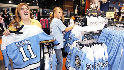 "Katelyn Feicht,16, of Shaler, left, and her cousin Haley Nightingale,12, of Collier Township, shop at Dick's Sporting Goods in Robinson for the blue ""throwback"" Penguins hockey jerseys."
