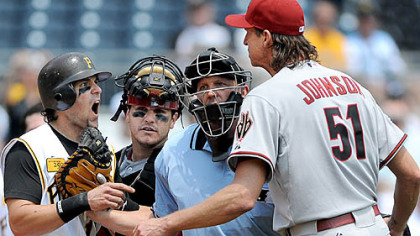 Pirates' Doug Mientkiewicz  and Diamondbacks' pitcher Randy Johnson, right are restrained from getting to each other.