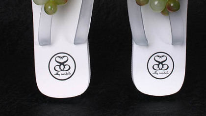 If wine tickles you down to your toes, how about wearing your heart on your feet with grape-topped flip-flops? $29.95 at sillysandals.com.
