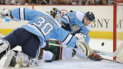 Alex Goligoski makes a save against The Wild in the second period at Mellon Arena last nght.