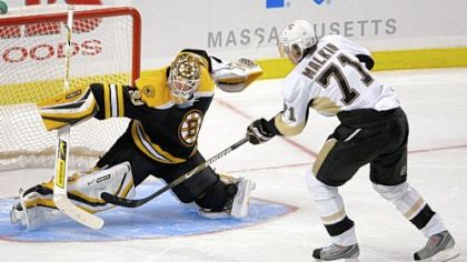 Bruins goalie Tim Thomas can't stop Evgeni Malkin from scoring the winning goal in the shootout last night in Boston.