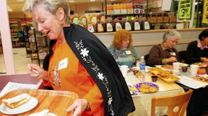 Lynn Kocon, a Franklin Regional adult education student, helps serves up the ultimate pumpkin pie at McGinnis Sisters in Monroeville.