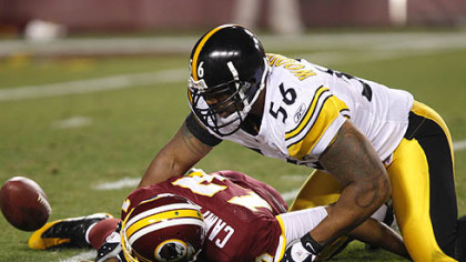 Redskins quarterback Jason Campbell is sacked by  linebacker LaMarr Woodley, right, during the third quarter of their Monday night football game. There was no fumble on the play, as Campbell was ruled down by contact. The Steelers won 23-6.