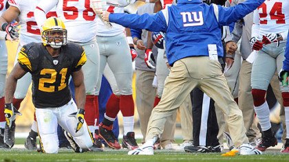 Giants coach Tom Coughlin argues a personal foul call on a hit against the Steelers' Mewelde Moore yesterday at Heinz Field.