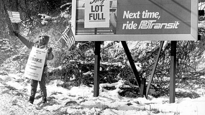 PAT driver Cindy Hoston of West Mifflin displays the colors to passersby on Lebanon Road in 1992.