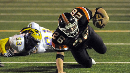 Bethel Park's Lyle Marsh scrambles for a few extra yards in the first half against Canon-McMillan last night.