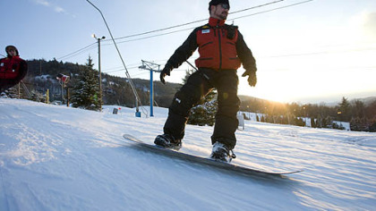 A member of the Ski Patrol cruises down Blue Mountain near Bethlehem, Pa.