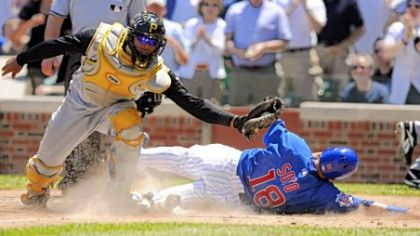 Ronny Paulino tags out Chicago's Geovany Soto at the plate.