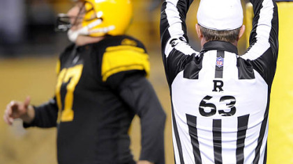 Referee Bill Carollo signals a safety in the fourth quarter. James Harrison, filling in for injured long snapper Greg Warren, snapped the ball over the head of punter Mitch Berger (pictured) and out of the end zone.