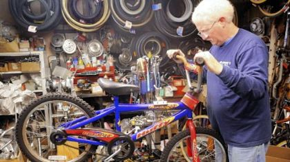 Jerry Kraynick checks out a bike donated for his Bikes for Christmas program Monday in his store, Kraynick's Bike Shop.