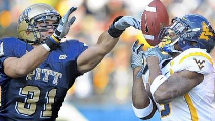Pitt's Dom DeCicco breaks up a pass intended for West Virginia's Jock Sanders.