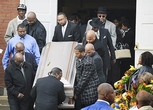 Pallbearers carry Michael Ross III's casket from the Allegheny Center