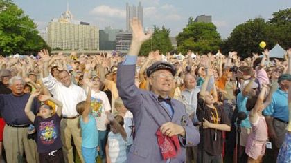Mr. McFeely waves with the crowd as part of the grand finale to Carl Kurlander&#039;s documentary &quot;A Tale of Two Cities.&quot;