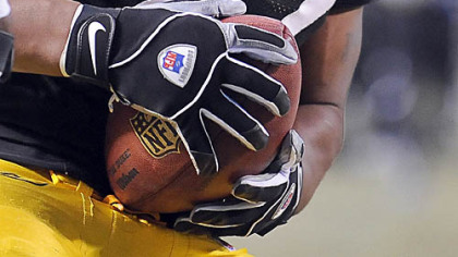 James Harrison comes away with the football after forcing a fumble against Cowboys quarterback Tony Romo yesterday at Heinz Field.