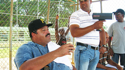Rene Gayo, the Pirates' Latin American scouting director, watches the pitching portion of the tryout, with one of his Dominican scouts, Marino Tejada, holding the radar gun.