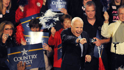 Republican Presidential nominee John McCain waves before speaking this evening at a rally at Robert Morris University&#039;s Sewall Center.