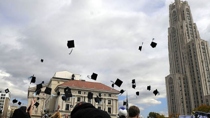 Actors and extras toss their mortarboards into the air while filming &quot;Sorority Row&quot; yesterday near the Cathedral of Learning in Oakland.