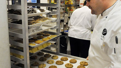 Big snack? Chef Hayes looks over fresh cookies at the cafeteria.