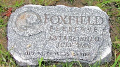 A flat stone marker that families can buy to mark graves at Foxfield Preserve.