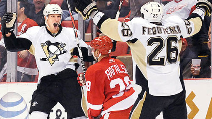 The Penguins' two heroes of the night, Jordan Staal, left, and Ruslan Fedotenko celebrate Fedotenko's winning goal in overtime last night at Joe Louis Arena in Detroit. It capped a wild and improbable comeback for the Penguins.