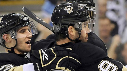 Pascal Dupuis is congratulated by teammate Alex Goligoski after his goal Saturday night. He has been adjusting well to the Penguins' top line.