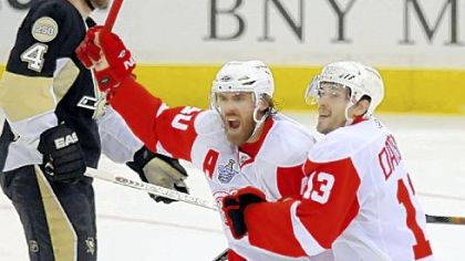 Henrik Zetterberg and Pavel Datsyuk celebrate Brian Rafalski&#039;s first-period goal against the Penguins in Game 6 of the Stanley Cup final June 4 at Mellon Arena. The Red Wings won the game and the Stanley Cup title.