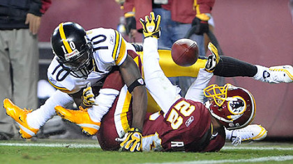The Redskins&#039; Carlos Rogers breaks up a pass intended for Santonio Holmes last night at FedEx Field in Landover, Md.