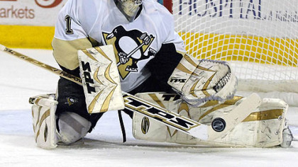 Penguins goalie John Curry makes a save on the Buffalo Sabres during the first period of last night&#039;s game in Buffalo. It was his first NHL career start.