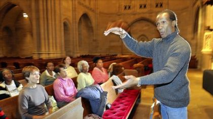 Herbert Jones directs a rehearsal of the Pittsburgh Gospel Choir, which will perform Saturday with the River City Brass Band in East Liberty Presbyterian Church.