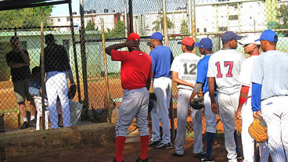 Players line up outside the scouting cage, waiting to introduce themselves to Rene Gayo, the Pirates' Latin American scouting director.