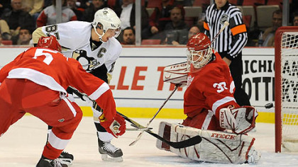 Penguins' Sidney Crosby scores against Redwings goalie Chris Osgood tonight at the Joe Louis Arena, Detroit.